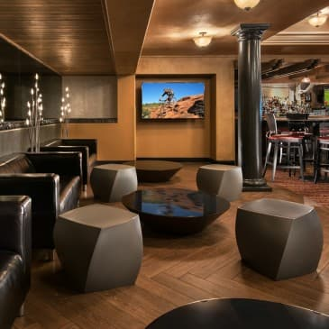 The contemporary lounge area in The Grille at ShadowRock.